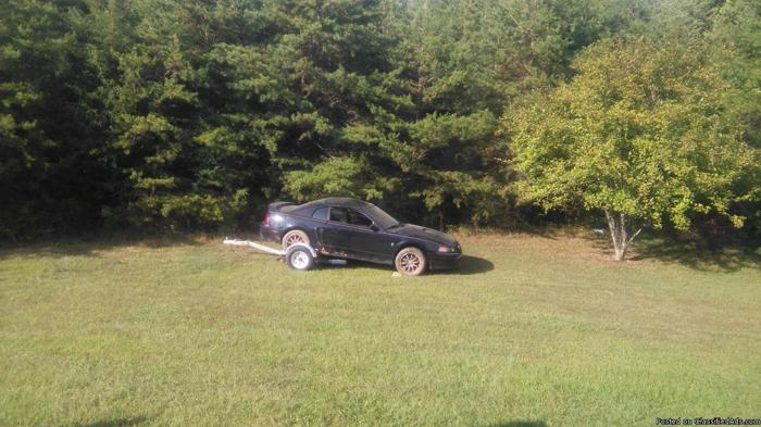 2003 mustang .2 cars just alike both have body damage. take two and make one.have all parts needed between both cars. both cars identical .black . handyman special $1950.00 .clean title