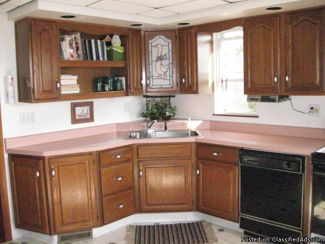 Entire Oak Kitchen Cabinets And Mauve Color Counter Top For Sale