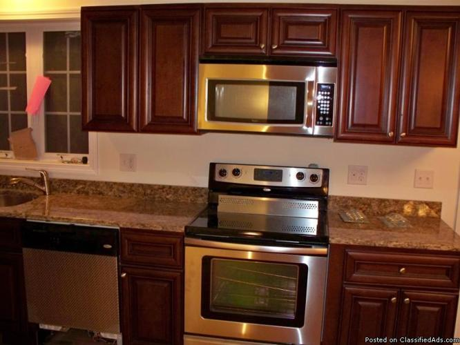 Raised panel cherrywood kitchen cabinets never installed for Cherry wood kitchen cabinets price