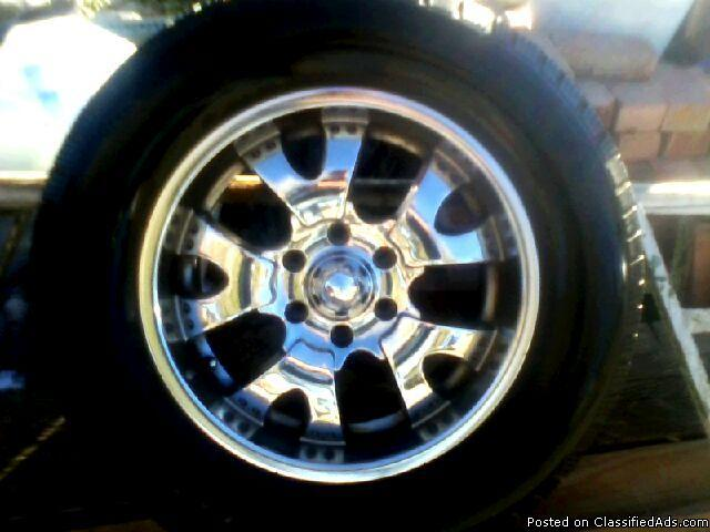 Rims 4 18 inch chrome rims with lug nuts and center caps, tires